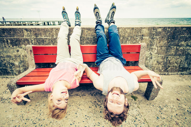 Young people friends relaxing on bench. royalty free stock images