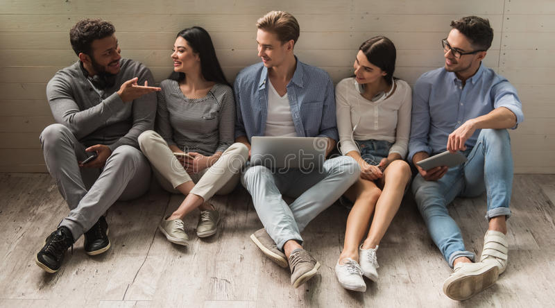 Young people with gadgets royalty free stock photos