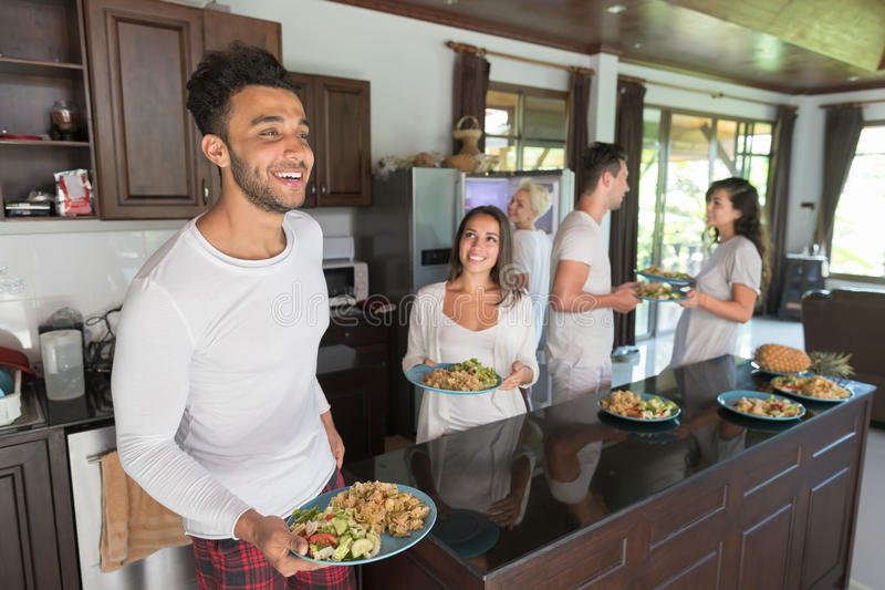 Young People Group Having Breakfast Together, Friends Kitchen Interior Morning Food Drink. Happy Smiling Holiday Vacation royalty free stock photos