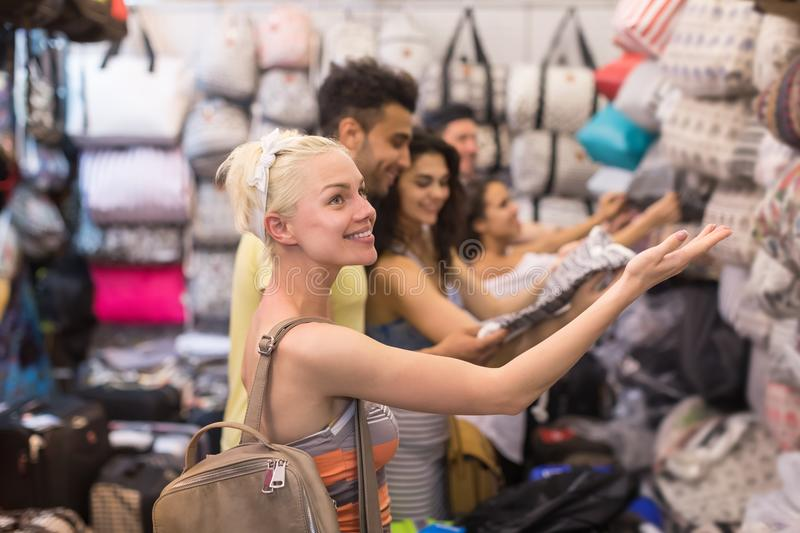Young People Group On Shopping Choosing Bag, Man And Woman Happy Smiling Buyers In Retail Store. Selecting Female Purse stock image