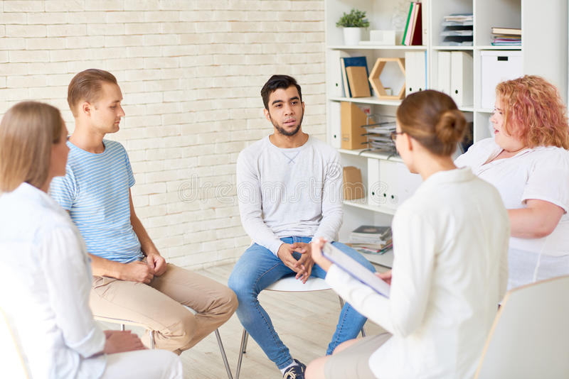 Young People in Group Therapy Session stock photos