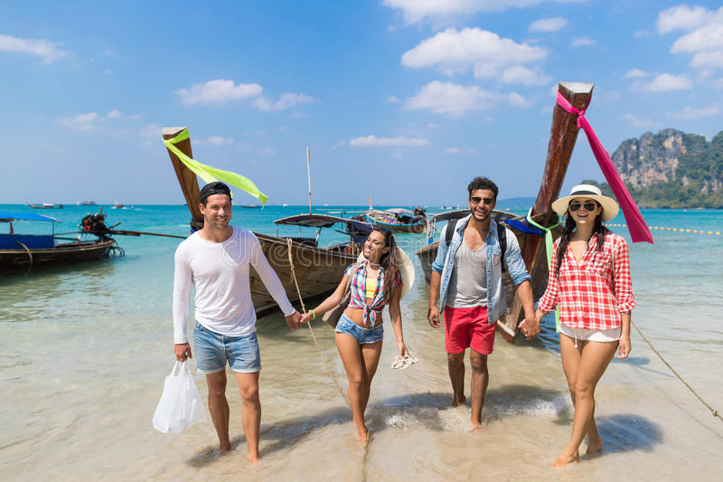 Young People Group Tourist Long Tail Thailand Boat Ocean Friends Sea Vacation Travel Trip stock photography