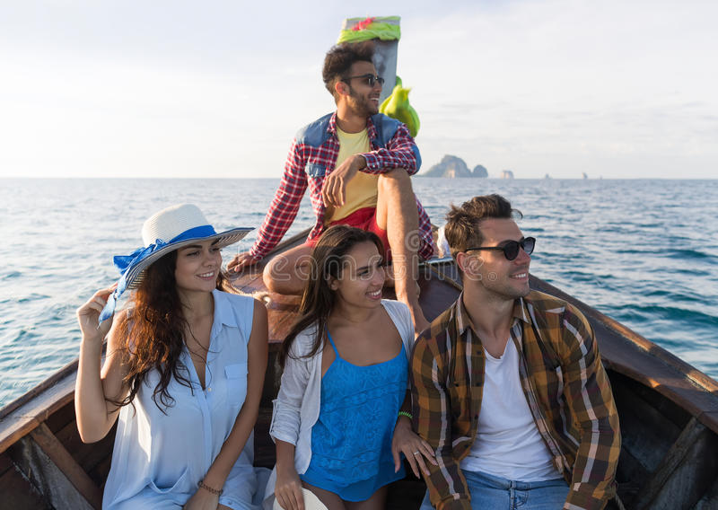 Young People Group Tourist Sail Long Tail Thailand Boat Ocean Friends Sea Vacation Travel Trip stock images