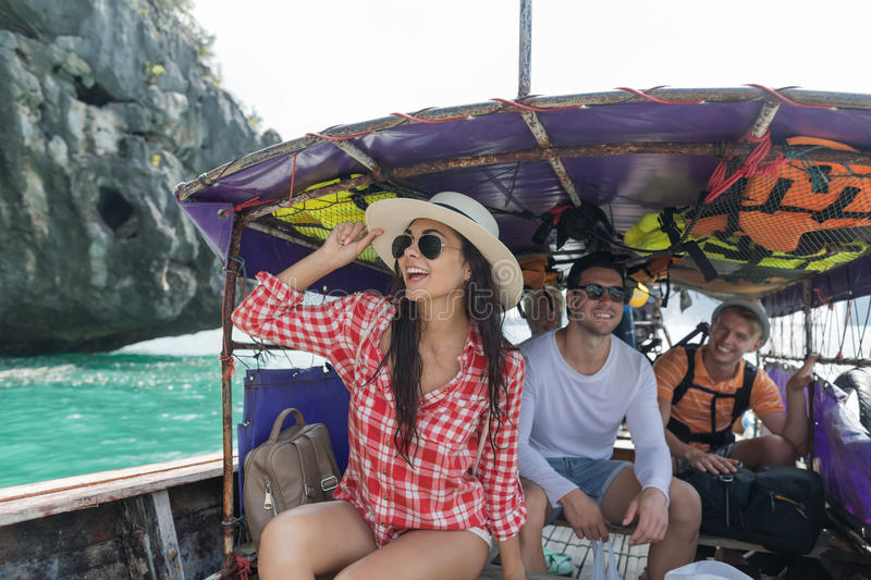 Young People Group Tourist Sail Long Tail Thailand Boat Ocean Friends Sea Vacation Travel Trip royalty free stock image