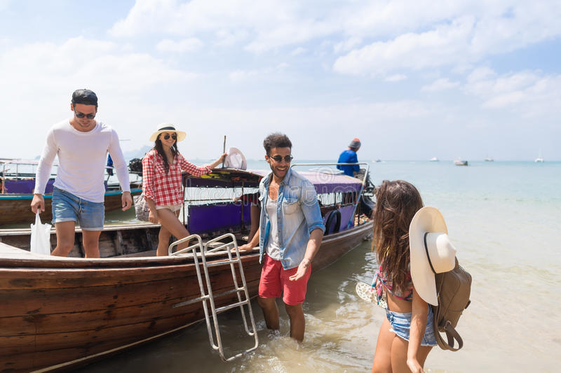 Young People Group Tourist Sail Long Tail Thailand Boat Ocean Friends Sea Vacation Travel Trip royalty free stock images