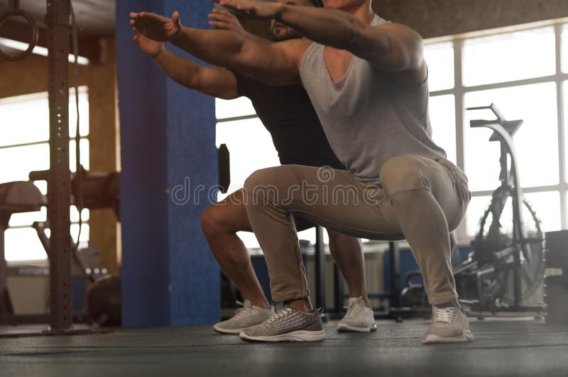 Small Group of Male Athletes During Workout in Gym royalty free stock photos