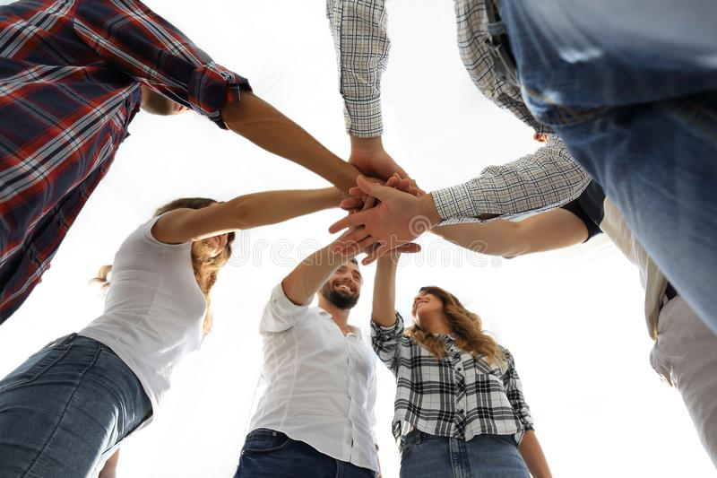 Young people with hands clasped together royalty free stock photos