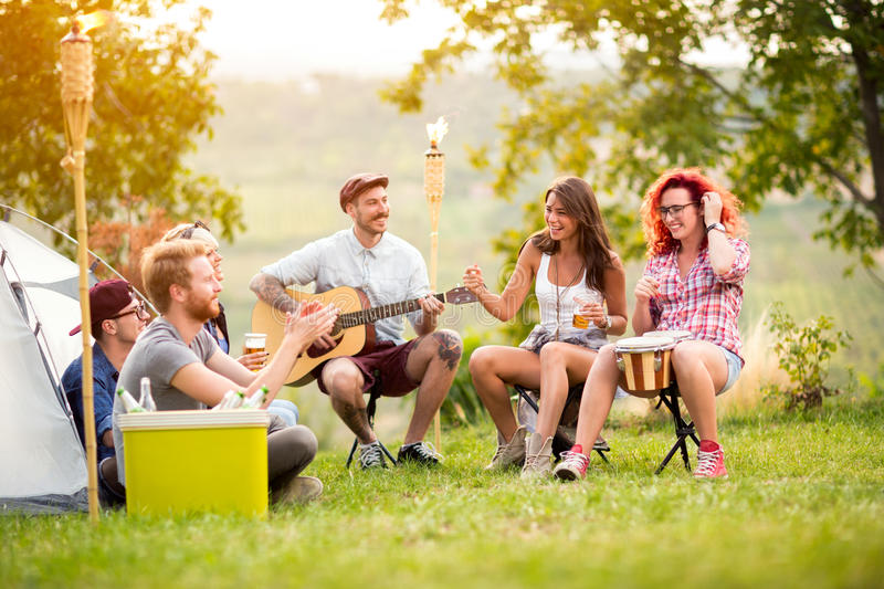 Young people have a good time in camp in nature. Young people have a good time in camp in beautiful nature stock images