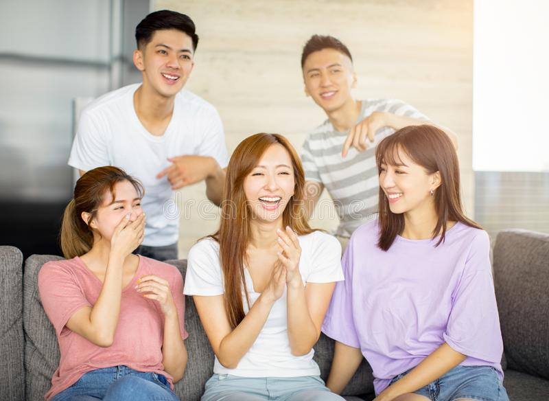 Young people having fun on the couch royalty free stock image