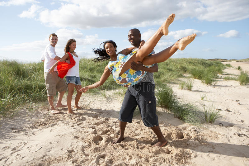 Young People Having Fun Dancing On Beach. Group Of Young People Having Fun Dancing On Beach Together stock photos
