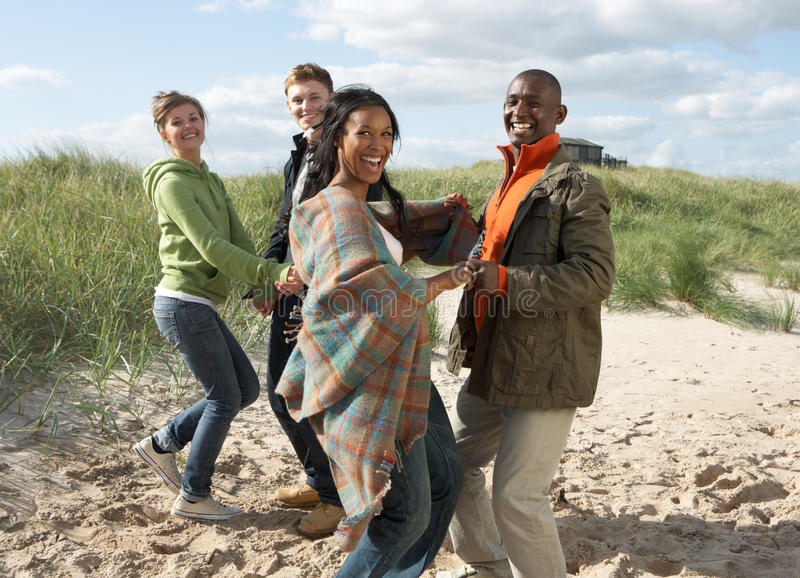 Young People Having Fun Dancing On Beach. Group Of Young People Having Fun Dancing On Beach Together royalty free stock photos