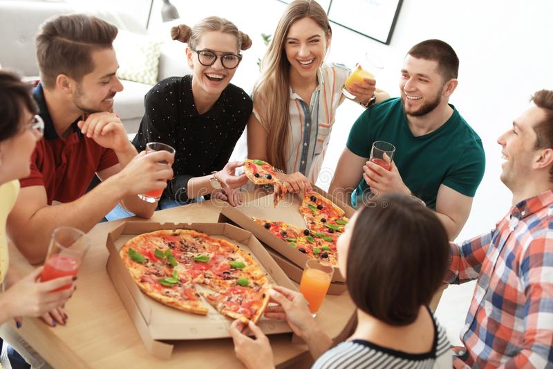 Young people having fun party with delicious pizza royalty free stock photo