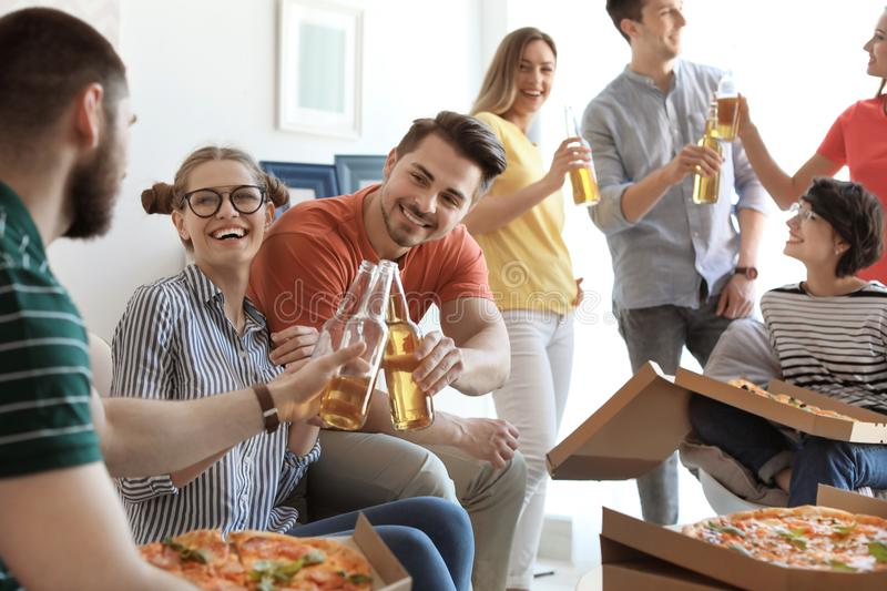 Young people having fun party with delicious pizza royalty free stock images