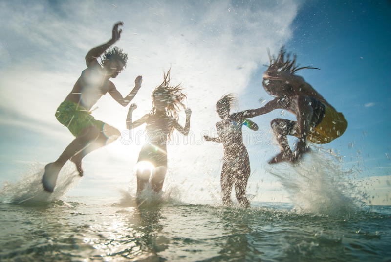 Young people having fun in the sea stock photos