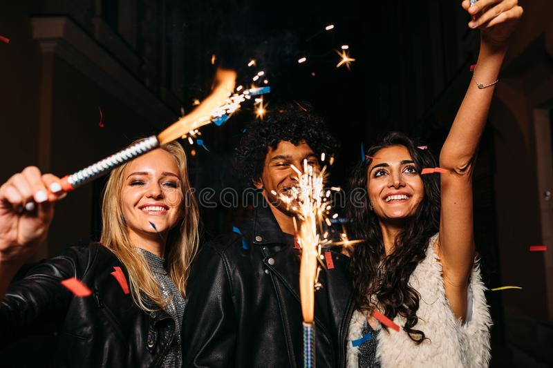 Young people having fun with sparklers outdoors royalty free stock photos