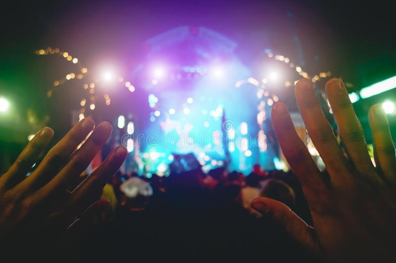 Young people having fun in summer concert  - Crowd rock music festival event stock photography