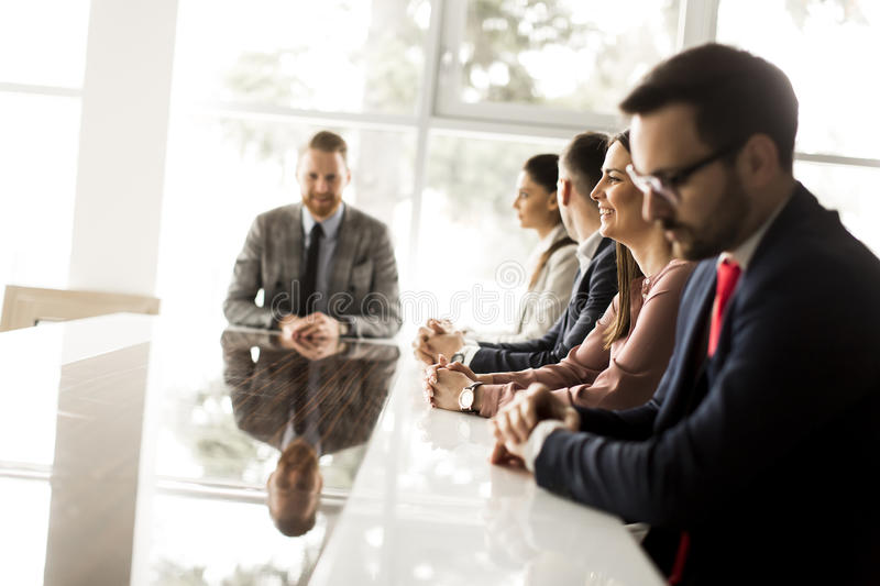 Young people having a meeting in the office stock photos