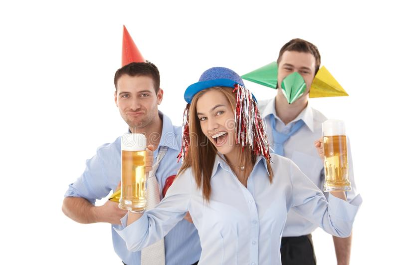Young people having party in office laughing royalty free stock photo