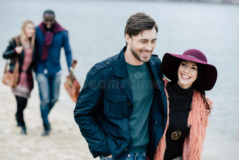 Young people having stroll on beach royalty free stock photography
