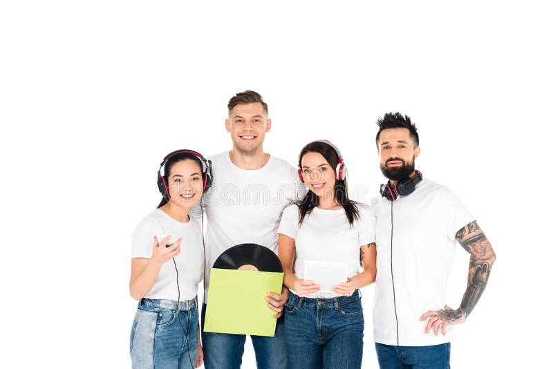 Young people in headphones holding vinyl record and gadgets isolated. On white stock image