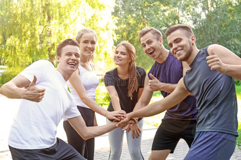 Young people holding hands together stock photos