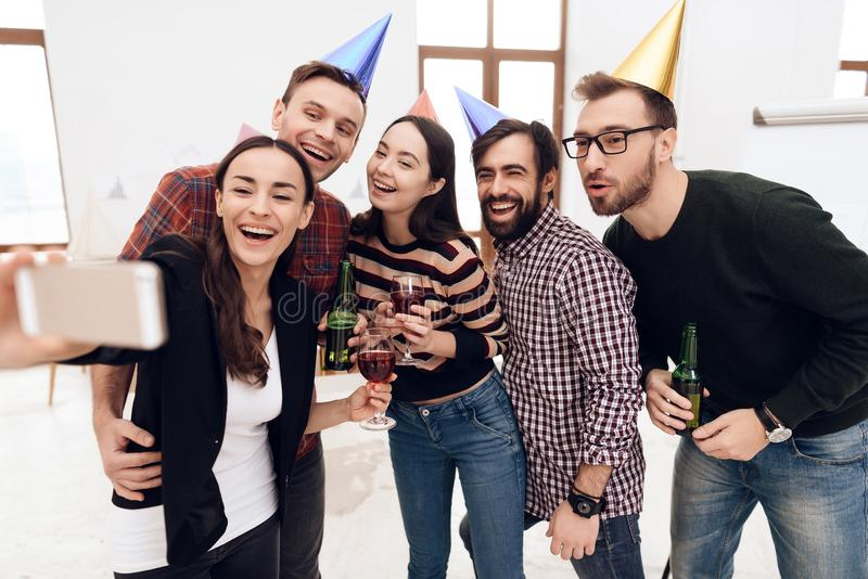 Young people in holiday caps do selfie. stock photography