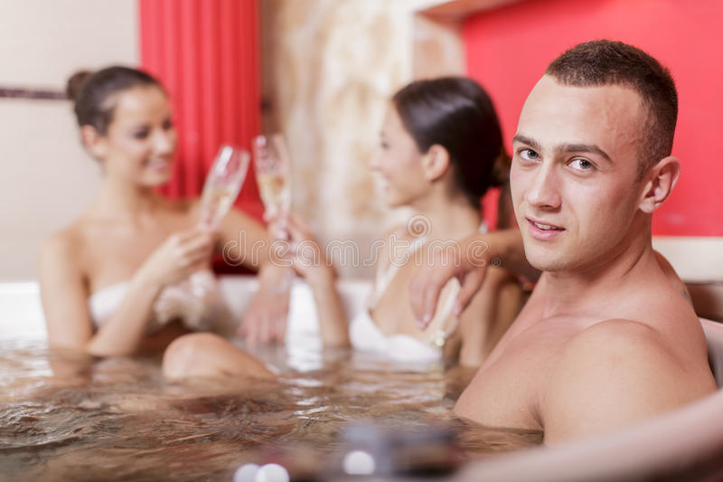 Young people in the hot tub royalty free stock photo