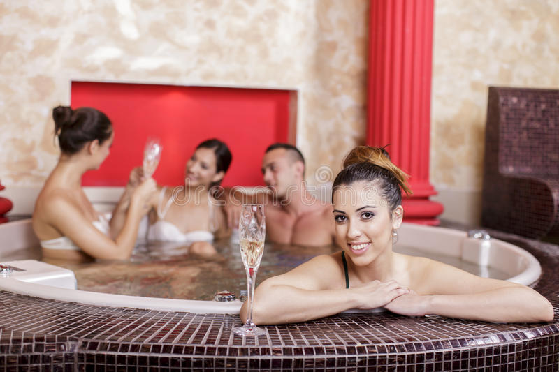 Young people in the hot tub stock photos
