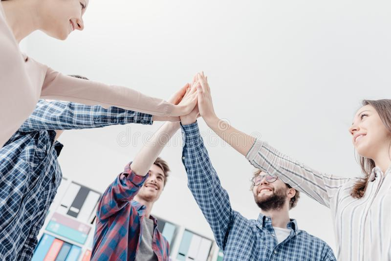 Young people joining hands together royalty free stock photos