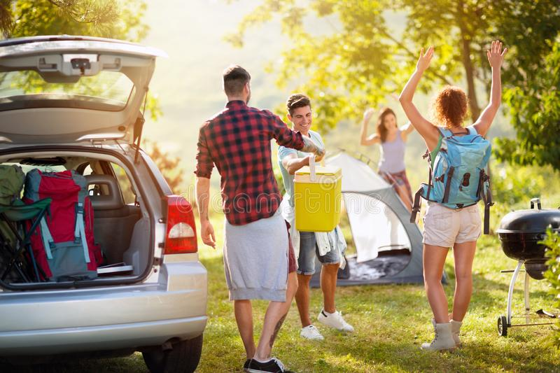 Young people just arrived on camping trip stock image