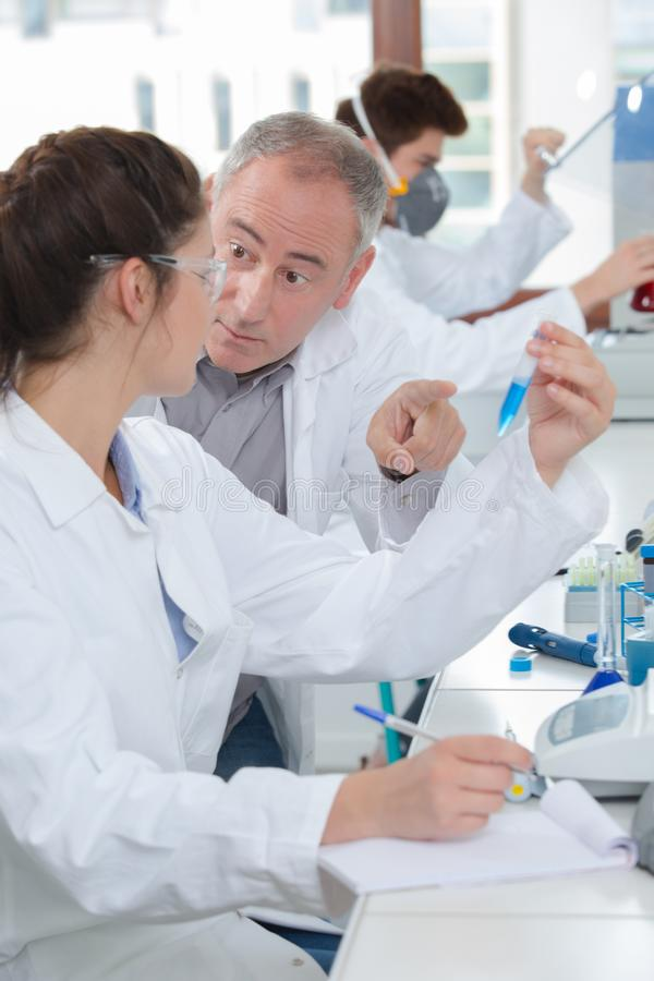 Young people in laboratory stock images