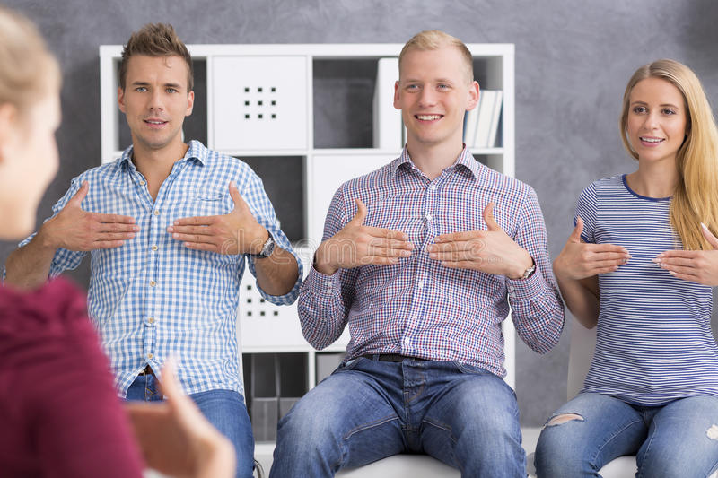 Young people learning sign language royalty free stock photo