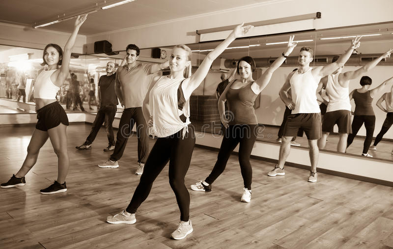 Young people learning zumba steps royalty free stock photo