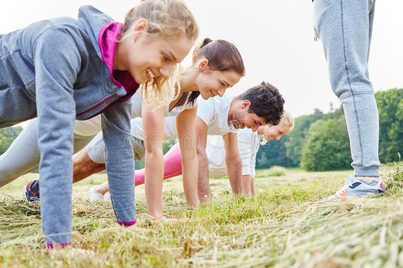 Young people making push ups. In training in nature royalty free stock images