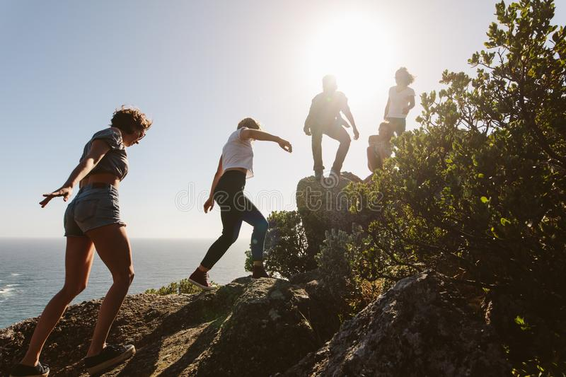 Young people on mountain hike on a summer day stock photo