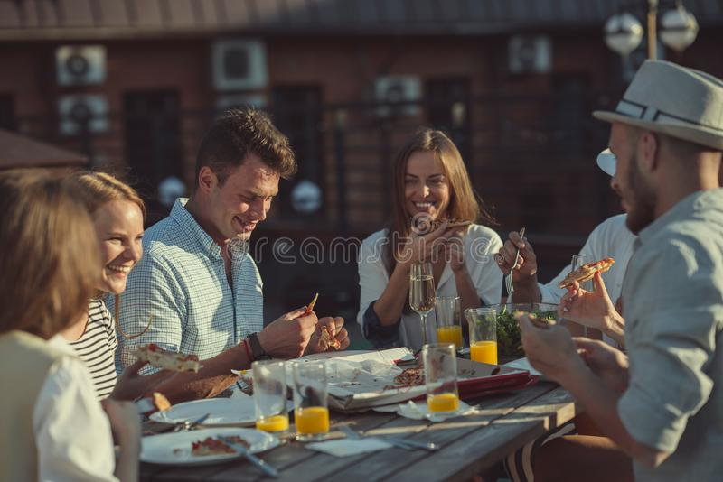 Young people at a party on the roof royalty free stock images