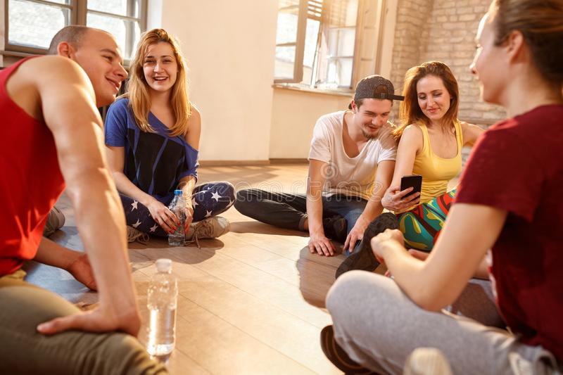 Young people on pause from dancing training royalty free stock image