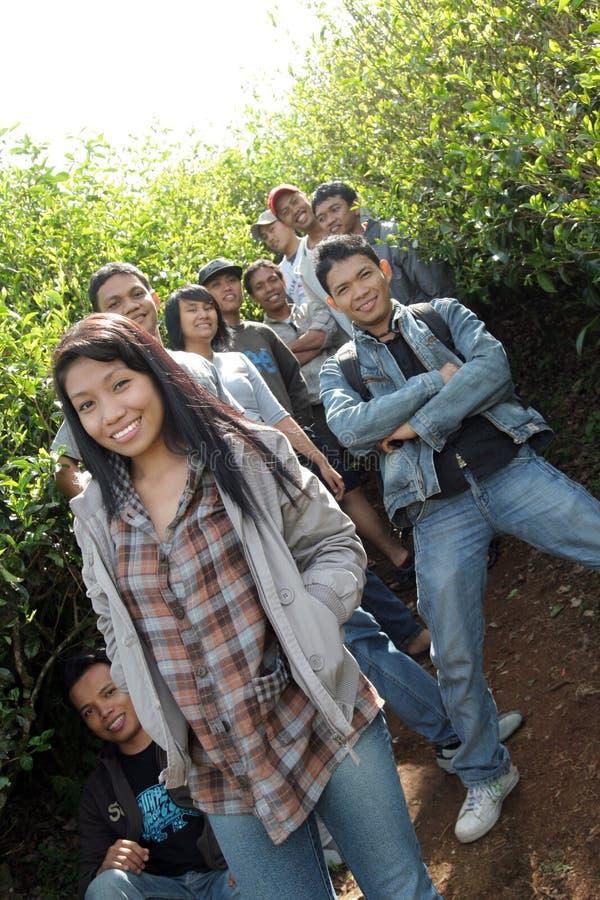 Young people at plantation royalty free stock photo