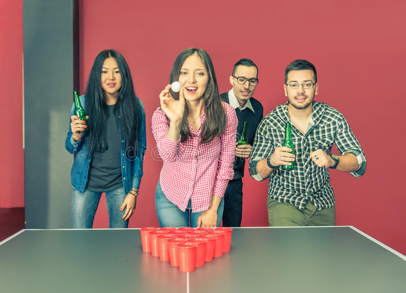 Young people playing beer pong stock photo