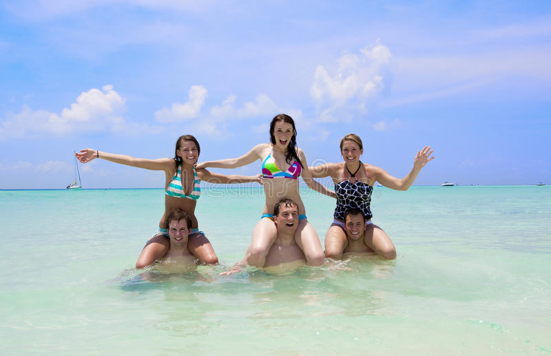 Young People Playing in the Ocean stock images