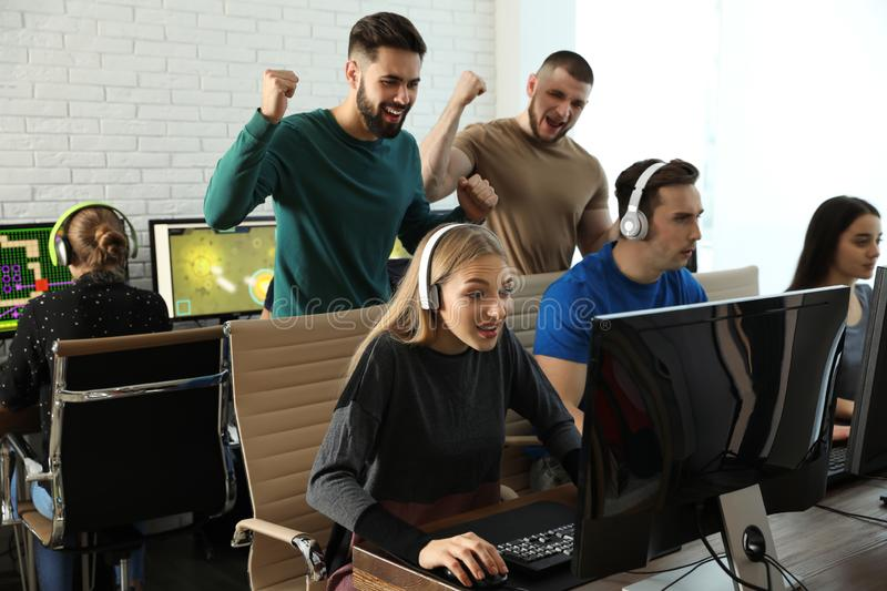 Young people playing video games on computers. Esports tournament stock image