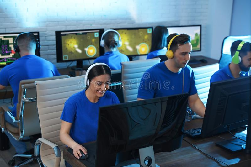 Young people playing video games on computers. Esports tournament stock photos