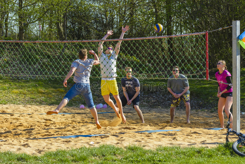 Young people playing volley. Unidentified young people play volley ball in Emmeringer Badesee park on April 19, 2015 in Emmering, Germany stock photos