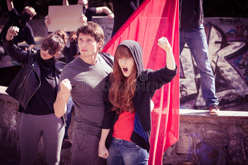Young people protesting. Street demonstration - young people protesting and rebelling stock image