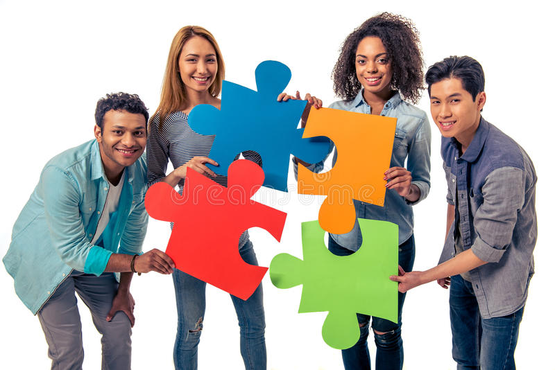 Young people with puzzles royalty free stock photo