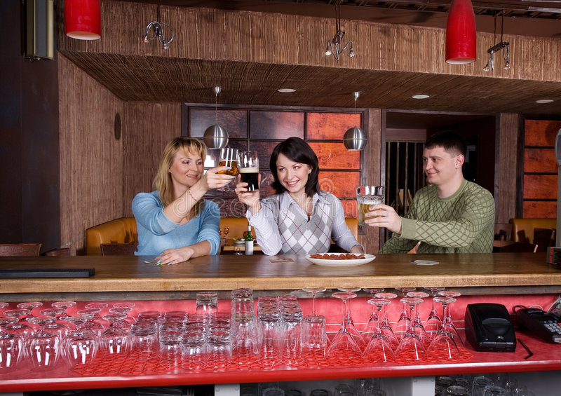 Young people at the restaurant royalty free stock image