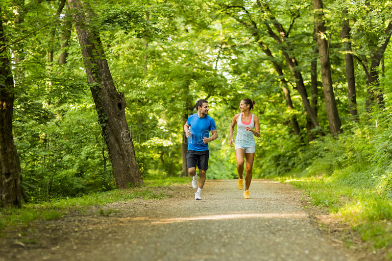 Young people running in nature stock photography