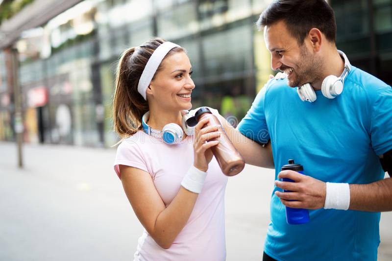 Young people running outdoors. Couple or friends of runners exercising. Together royalty free stock photos