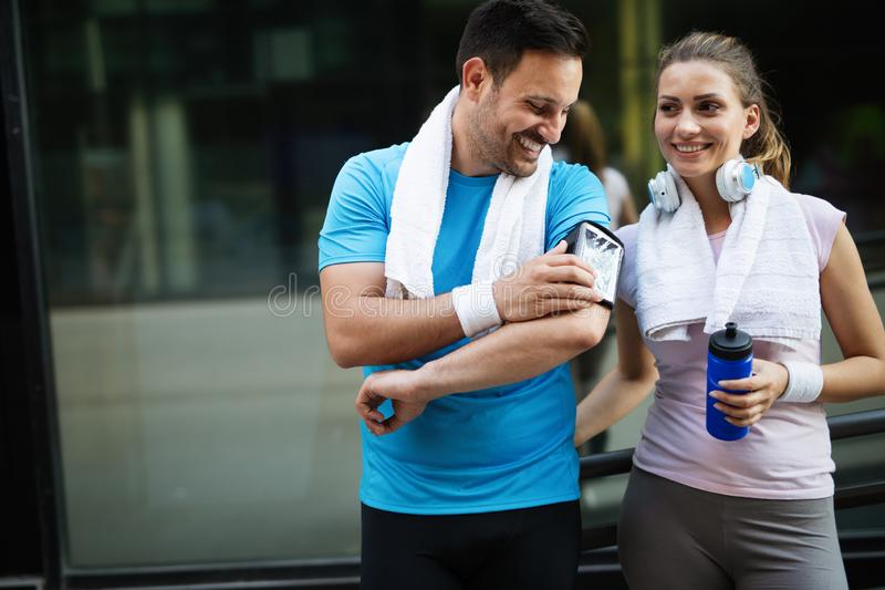 Young people running outdoors. Couple or friends of runners exercising. Together stock photos