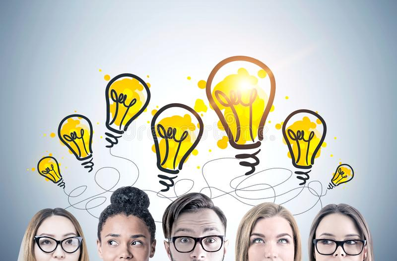 Young people s heads, light bulbs royalty free stock photos